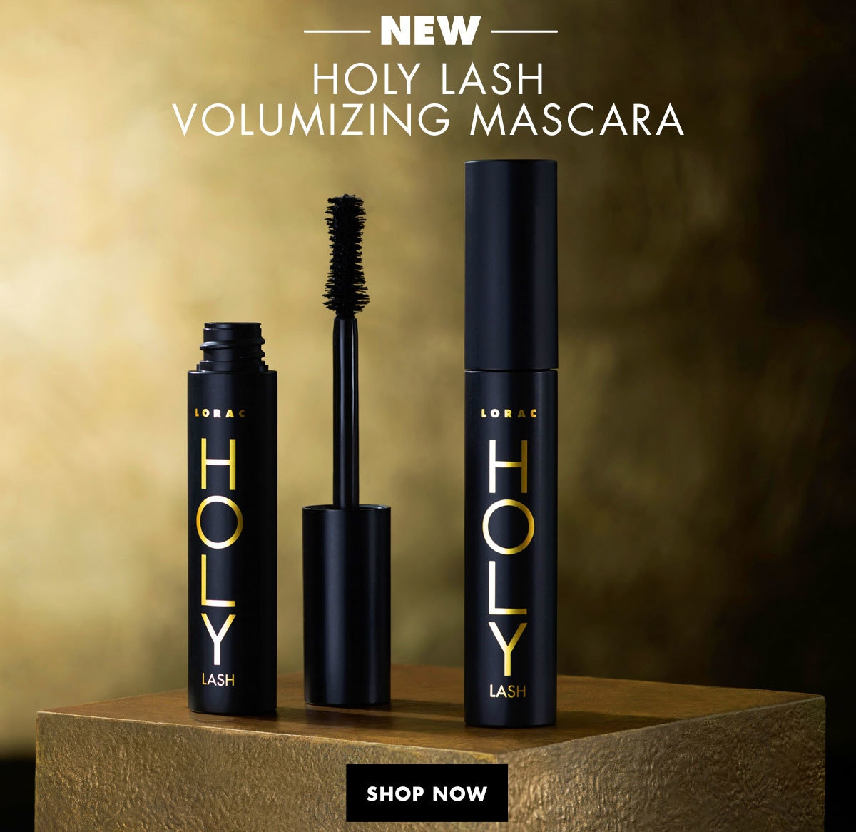 NEW Holy Lash Volumizing Mascara | Shop Now | Lorac | Product front facing, one with cap removed and one with cap fastenend, with beige and black background